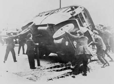 To right an overturned bus during the general strike in 1926
